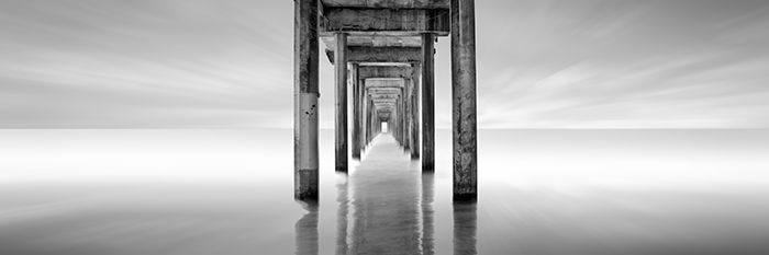 """Scripps Pier"" © kevin saint greyI went to college at the University of California, San Diego, well before I had picked up a camera. I go back a lot to photograph many of the places I had visited during my college years and Scripps Pier (which is actually owned by UCSD) is one of them. Every time I photograph this pier from this angle, someone always stands in front of my camera and stares down it and I end up having to wait for them to move. It makes me feel invisible which would be a nice trait to have if I ever decide to do street photography one day."