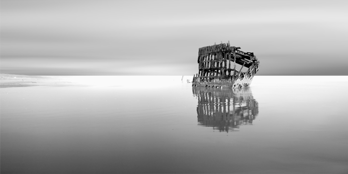 """the Iredale"" © kevin saint grey Earlier this year, I visited a good friend in Washington and we took a short weekend trip down the Oregon coast. I had seen images of this shipwreck previously and knew I wanted to photograph it, but wasn't sure if it was going to be on our path. We completely miscalculated the tide times but it ended up working in my favor here."