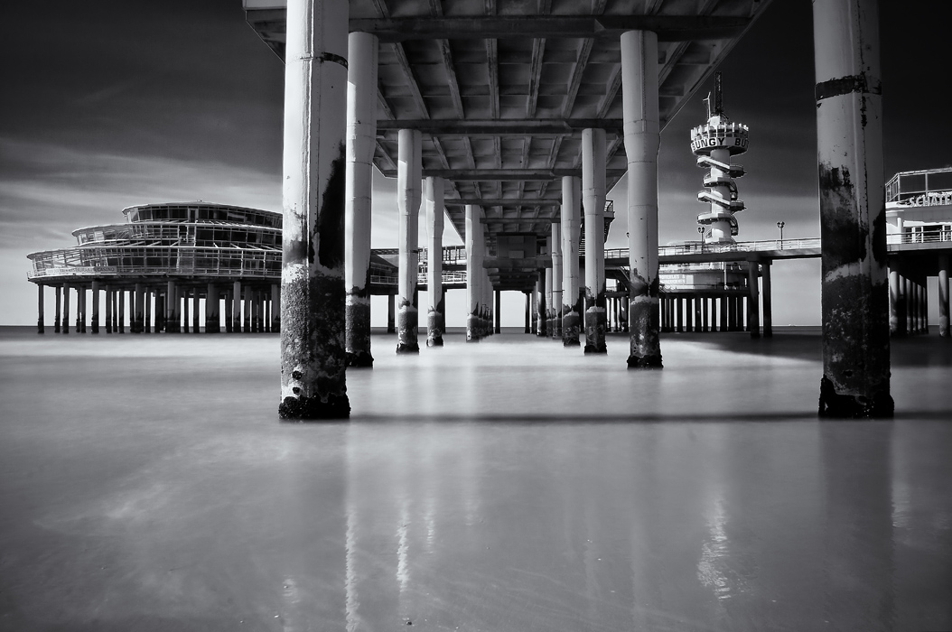 Scheveningen Pier  (c) Joel Tjintjelaar   This is both the first long exposure photograph I took andmy very first published  image: it was published in American Photo magazine in 2009 along with Groynes and  Curves. And although I feel it is technically not great, it has the look my images  still have: high contrast but with a lot of other tones in between. I was still  searching back then.  I didn't have any favorite long exposure photographer at  that time. This image will forever have a special place in my heart.
