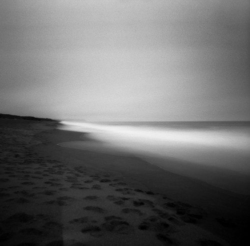 "The return of the light (c) J. M. Golding I chose ""The return of the light"" as an example of my long exposure photography. The brightness at the edge of the waves reminded me of a promise that the light would return in the morning. I made this photograph using a Zero Image 6x9 pinhole camera on Ilford FP 4+ film, with an exposure time of one minute. I developed the film in Adonal (Rodinal) diluted 1+100 for 20 minutes. The image you see here is similar to the appearance of the silver gelatin print."